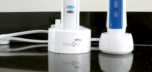 Docking stations for electric toothbrushes