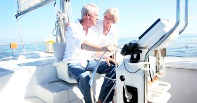 A retired senior couple on a boat