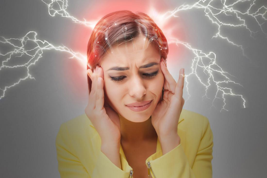 woman with migraine attack