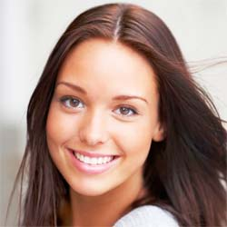 Lady with dark hair smiling at the camera