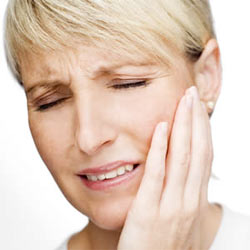 Sinusitis symptoms - lady holding her face